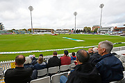 Spectators waiting patiently for play to begin after rain delayed start of play. The ground sheets covering the square have been removed and a pitch inspection is due at 2:30pm during the Specsavers County Champ Div 1 match between Somerset County Cricket Club and Essex County Cricket Club at the Cooper Associates County Ground, Taunton, United Kingdom on 25 September 2019.