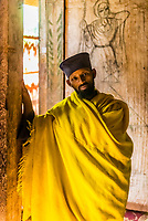 A monk stands inside the Ura Kidane Mehret, a church of the Ethiopian Orthodox Church, located on the Zege peninsula around Lake Tana in Ethiopia.<br /> The church dates back to the 16th century and typical of churches in Ethiopa, Ura Kidane Mehret is circular in shape on the outside. Inside, the actual chapel is six sided and the walls on all six sides are beautifully painted frescoes depicting various scenes from biblical lore and the history of the Ethiopian Orthodox Church.