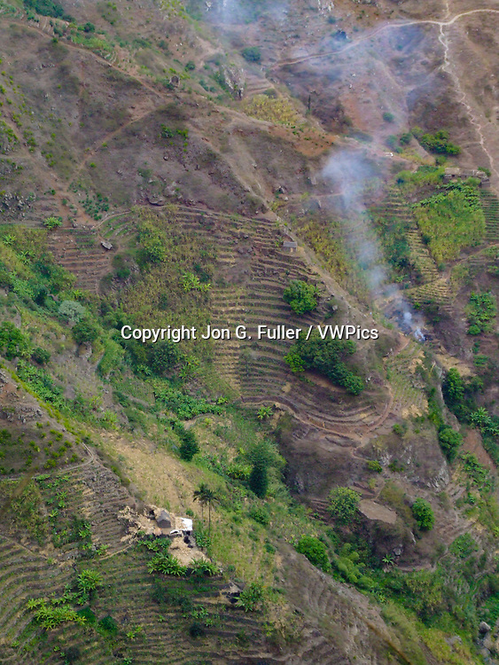 Small farms grow sugar cane on terraces on the steep mountainsides of Santo Antao, Republic of Cabo Verde, Africa.