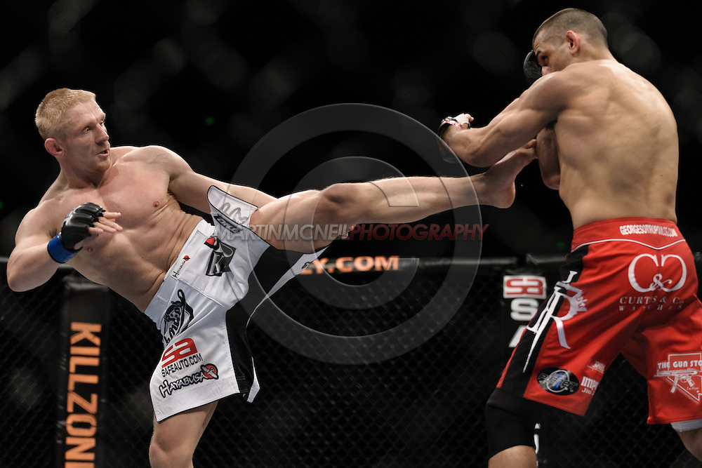 """SYDNEY, AUSTRALIA, FEBRUARY 27, 2011: Dennis Siver (left) throws a kick towards George Sotiropoulos during """"UFC 127: Penn vs. Fitch"""" inside Acer Arena in Sydney, Australia on February 27, 2011."""