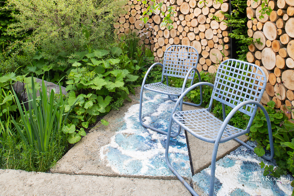 A paved seating area in Viking Cruises: The Art of Viking Garden at the RHS Chelsea Flower Show 2019, London, UK