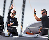 Dona Bertarelli and Yann Guichard aboard their multihull, Spindrift 2, at the start of the 90th anniversary Rolex Fastnet Race on the Solent. A record fleet of 370 yachts will compete to win the Fastnet Challenge Cup.<br /> The 600 nautical mile race starts in Cowes, Isle of Wight, heading to the Fastnet Rock off the south west coast of Ireland and finishes in Plymouth.<br /> It is the world's biggest offshore race with 75% amateur sailors and professional yachtsmen competing against each other. <br /> Picture date Sunday 16th August, 2015.<br /> Picture by Christopher Ison. Contact +447544 044177 chris@christopherison.com