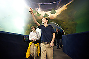 Patrons enjoy the under watter tube at the Cleveland Aquarium on Monday, Feb. 6, 2012.
