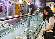 EXCLUSIVE<br /> A DEFECTOR'S LIFE IN SOUTH KOREA<br /> <br /> Kim is 16 years old and lives in Seoul, South Korea. She looks like any other teenager when you see her shopping in the street. But like 28,000 other refugees, she has escaped from North Korea.One morning in 2011, her mother could no longer bear the misery, lack of freedom and food deprivation, so she and her daughter escaped to seek refuge in the wealthy ultra-modern South Korea. Kim was 10 and had to leave the rest of her family, her friends and her school without even having the chance to say goodbye.<br /> They fled their country in secret by crossing on foot and by night the river making up the border with China. Their journey to reach South Korea took eight long months. After making it to China, her mother used her meager savings to pay smugglers to enter Laos, Thailand and finally South Korea. They arrived in the Land of Morning Calm in 2012.<br /> <br /> Photo shows:   On the weekend, the girls from the dormitory reunite with their families while Kim often stays behind, alone. She uses the opportunity to rest and read Korean mangas. She enjoys preparing a surprise meal for her friends when they return. She loves to cook with aloe but her guilty pleasure is ice cream. She loves buying a 5-litre container to share with her friends while watching a DVD on Sunday night, before resuming the work week. Kim barely ever talks about her past with her co-tenants. They all have a painful or buried secret they refuse to talk about.<br /> &copy;Eric Lafforgue/Exclusivepix Media