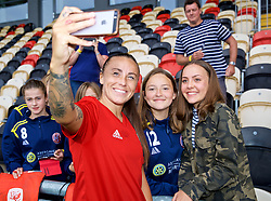 NEWPORT, WALES - Thursday, August 30, 2018: Wales' Natasha Harding poses for a selfie photograph with young supporters after a training session at Rodney Parade ahead of the final FIFA Women's World Cup 2019 Qualifying Round Group 1 match against England. (Pic by David Rawcliffe/Propaganda)