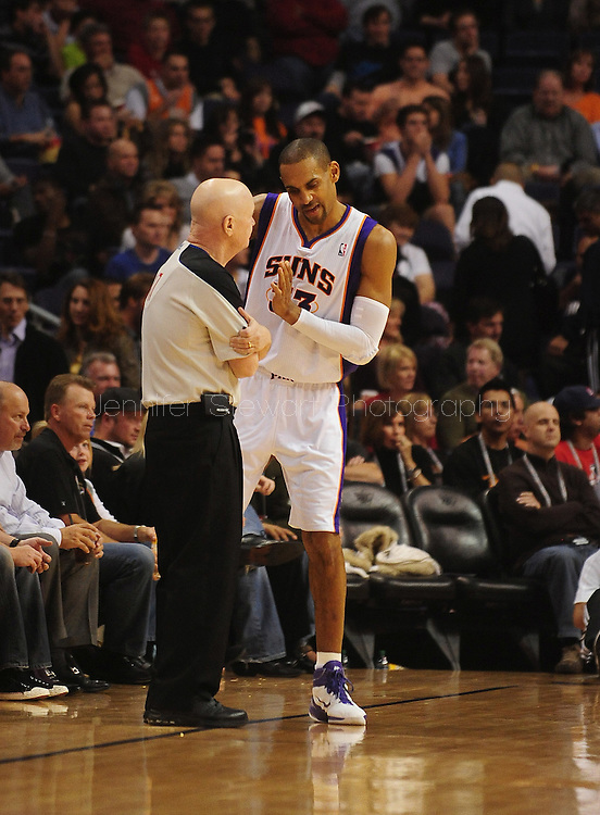 Dec. 10 2010; Phoenix, AZ, USA; Phoenix Suns forward Grant Hill (33) talks with NBA official Joe Crawford during the second half against the Portland Trailblazers at the US Airways Center.  The Trailblazers defeated the Suns 101-94. Mandatory Credit: Jennifer Stewart-US PRESSWIRE.