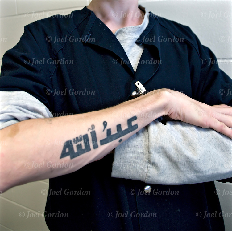 Muslim Inmate showing his tattoo.<br />