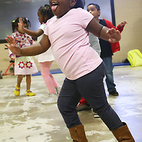 Lauren Wood | Buy at photos.djournal.com<br /> Zoee Shumpert dances as an airplane as she and other students dance with Mary Frances Massey Friday morning during music at ECEC.