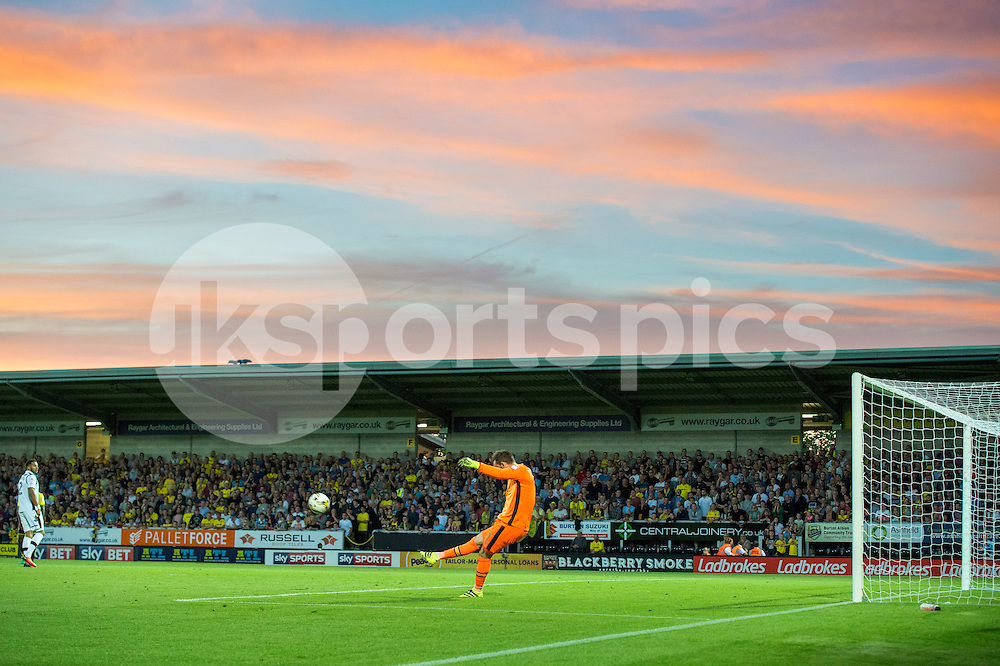 Scott Carson of Derby County clears the ball during the EFL Sky Bet Championship match between Burton Albion and Derby County at the Pirelli Stadium, Burton upon Trent, England on 26 August 2016. Photo by Brandon Griffiths.