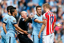 referee Lee Mason intervenes as Stevan Jovetic of Manchester City and Ryan Shawcross of Stoke tussle - Photo mandatory by-line: Rogan Thomson/JMP - 07966 386802 - 30/08/2014 - SPORT - FOOTBALL - Manchester, England - Etihad Stadium - Manchester City v Stoke City - Barclays Premier League.