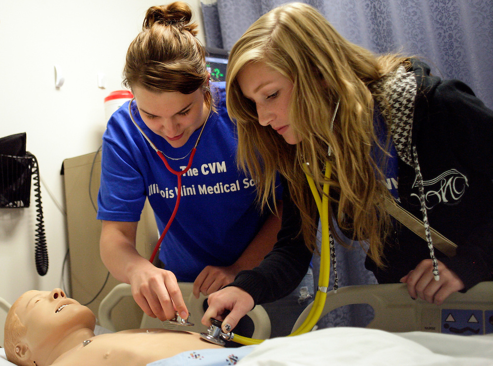 (20110612, Rock Island, Illinois)..Amanda Johnson of Moline High School, left, and Jillian Jespersen, right, of Rock Island High School, use stethoscopes on a simulated patient during CVM-IL Mini Medical School in Rock Island, Illinois on Sunday, June 12, 2011.  The two day program for selected Quad Cities-Area students includes hands-on patient simulations and lectures by doctors and is funded by physicians from Cardiovascular Medicine, P.C. in Illinois through the Trinity Health Foundation...Photo by Brooks Canaday..med school, medical, trinity, high school, health.