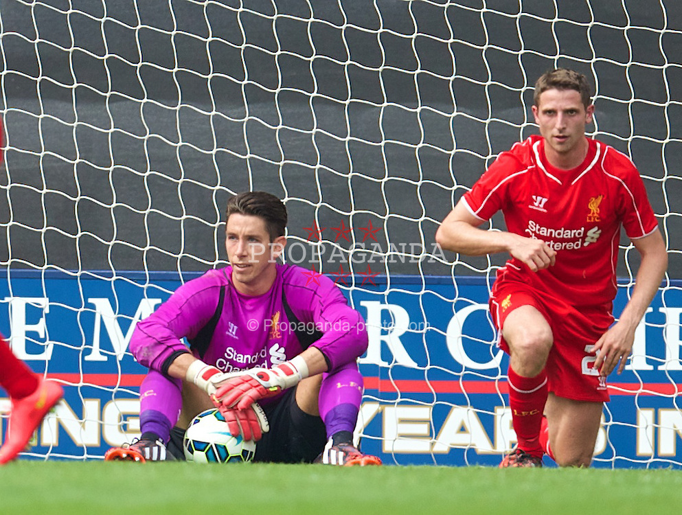 PRESTON, ENGLAND - Saturday, July 19, 2014: Liverpool's goalkeeper Brad Jones and Joe Allen look dejected as Preston North End score the opening goal during a preseason friendly match at Deepdale Stadium. (Pic by David Rawcliffe/Propaganda)