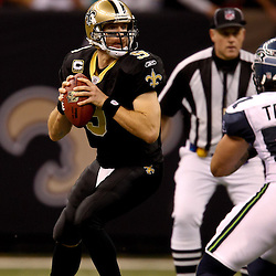 November 21, 2010; New Orleans, LA, USA; New Orleans Saints quarterback Drew Brees (9) looks to pass during the second half against the Seattle Seahawks at the Louisiana Superdome. The Saints defeated the Seahawks 34-19. Mandatory Credit: Derick E. Hingle