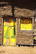Africa, Ethiopia, Konso mud hut with vivid door and window
