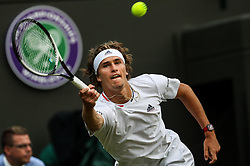 LONDON, July 6, 2018  Alexander Zverev of Germany hits a return during the men's singles second round match against Taylor Fritz of the United States at the Wimbledon Championships 2018 in London, Britain, on July 5, 2018. (Credit Image: © Tang Shi/Xinhua via ZUMA Wire)