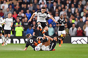 Derby County midfielder Tom Lawrence (10) clears Fulham defender Ryan Fredericks (2) and Fulham midfielder Kevin McDonald (6) during the EFL Sky Bet Championship match between Derby County and Fulham at the Pride Park, Derby, England on 11 May 2018. Picture by Jon Hobley.