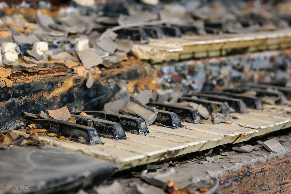 Piano in a home destroyed by Hurricane Katrina a year and a half after the storm in New Orleans East.