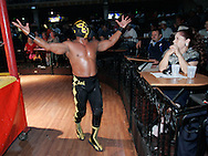 """Viva Puerto Riiiiiico,"" shouts Hijo de Pierroth as he makes his entrance into Pharr's Tejano Saloon.  The subject of constant insults and obscene gestures, he seems to enjoy being disliked."