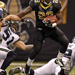 November 21, 2010; New Orleans, LA, USA; New Orleans Saints running back Chris Ivory (29) breaks away from Seattle Seahawks linebacker Lofa Tatupu (51) during a game at the Louisiana Superdome. Mandatory Credit: Derick E. Hingle