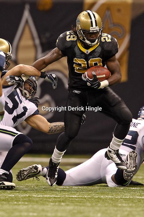 November 21, 2010; New Orleans, LA, USA; New Orleans Saints running back Chris Ivory (29) breaks away from Seattle Seahawks linebacker Lofa Tatupu (51) during a game at the Louisiana Superdome. Mandatory Credit: Derick E. Hingle