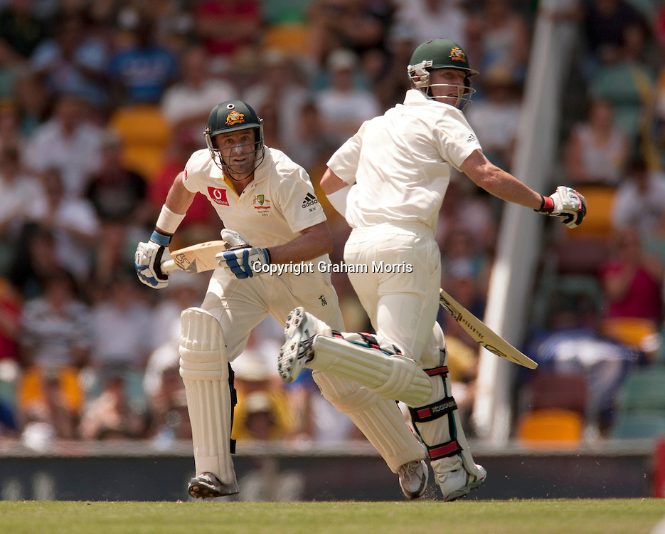 Michael Hussey and Brad Haddin (right) head towards their centuries in a 307 partnership during the first Ashes Test Match between Australia and England at the Gabba, Brisbane. Photo: Graham Morris (Tel: +44(0)20 8969 4192 Email: sales@cricketpix.com) 27/11/10