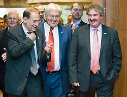 Frank-Walter Steinmeier, Germany's foreign minister, center,  shares a laugh with Javier Solana, the EU's foreign policy chief, left, and Jean Asselborn, Luxembourg's foreign minister, right, as they arrive for the start of the European Summit, in Brussels, Thursday, June 18, 2009. (Photo © Jock Fistick)