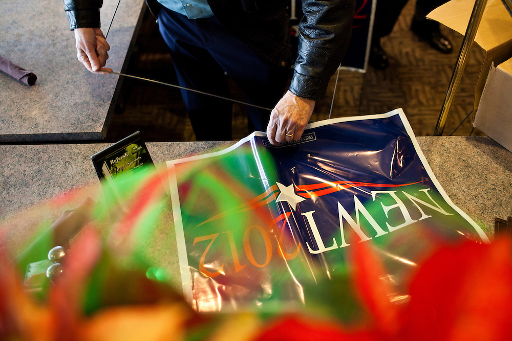 A campaign worker assembles yard signs for Republican presidential candidate Newt Gingrich at Tish's Restaurant on Saturday, December 31, 2011 in Council Bluffs, IA.