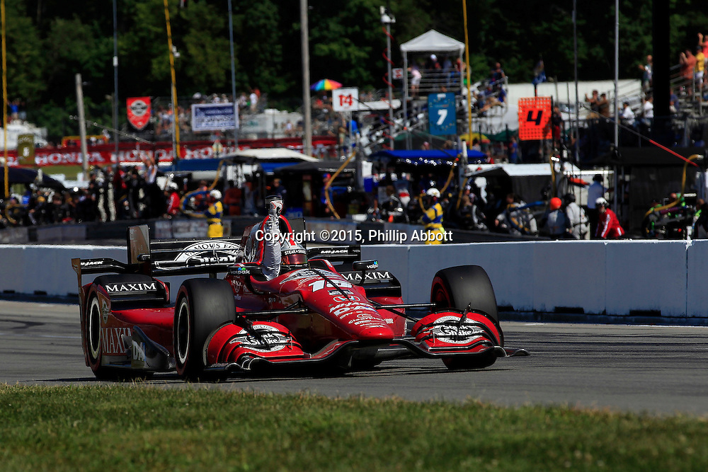 31 July - 2 August, 2015, Lexington, Ohio USA<br /> Graham Rahal celebrates with a fist pump<br /> &copy;2015, Phillip Abbott<br /> LAT Photo USA