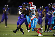 Dental Jones (42) of the Lincoln Tigers is tackled by Jeriah Hunt (22) of the Carter Cowboys during a high school football game at Forester Stadium in Dallas, Texas on September 18, 2015. (Cooper Neill/Special Contributor)