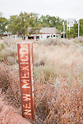 An old rusted marker is stake at the border of Texas and New Mexico along Route 66. Missoula Photographer