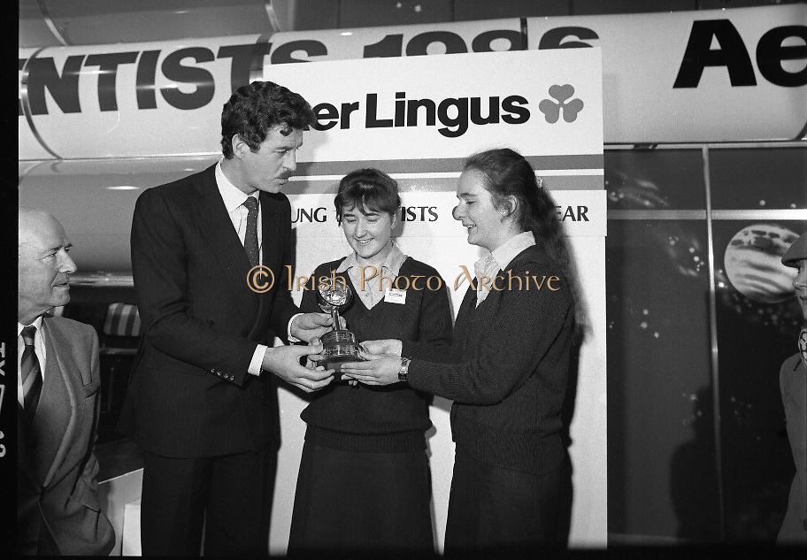 """Aer Lingus Young Scientist Exhibition..1986..10.01.1986..01.10.1986..10th January 1986..The annual Aer Lingus,sponsored,Young Scientists Exhibition was held at the RDS,Ballsbridge,Dublin.The Overall winners of the competition were Ms Breda Maguire and Ms Niamh Mulvany..They are students at The Rosary College,Raheny,Dublin. The Tanaiste, Mr Dick Spring TD was on hand to present the awards...Photograph shows Ms Breda Maguire,Edenmore Grove,Raheny and Ms Niamh Mulvany,Buttercup Park,Darndale being presented with their award by Tanaiste Mr Dick Spring TD. Breda and Niamh won the coveted title of """"Young Scientists Of The Year""""."""