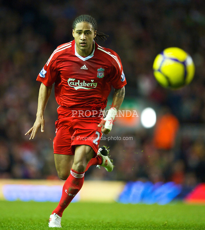 LIVERPOOL, ENGLAND - Sunday, December 13, 2009: Liverpool's Glen Johnson in action against Arsenal during the Premiership match at Anfield. (Photo by: David Rawcliffe/Propaganda)