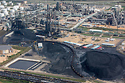 Uncovered rail cars Loading Petroleum Coke, a byproduct of tar sands refining at Pine Bend Refinery.
