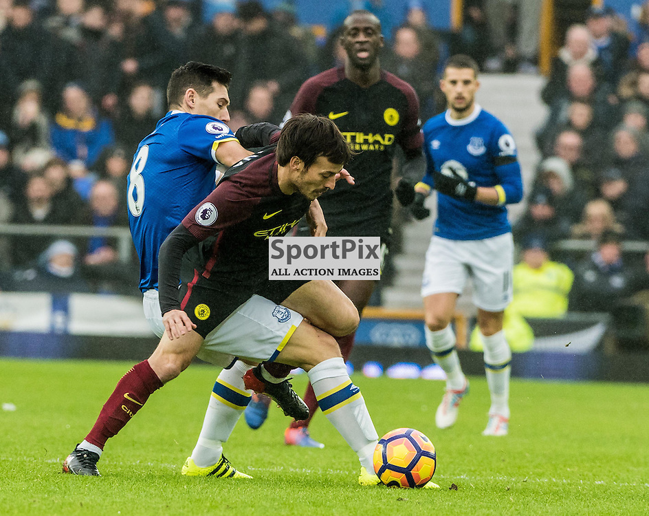 Manchester City midfielder David Silva (21) and Everton midfielder Gareth Barry (18) challenge for a loose ball in the Premier League match between Everton and Manchester City<br /> <br /> (c) John Baguley | SportPix.org.uk