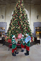 Former Kansas City Royals first baseman Mike Sweeney helps launch Farmland's Bacon for Santa Campaign at Union Station, Tuesday, Dec. 8, 2015, in Kansas City, Mo. From now until December 24th, Farmland will donate one pound of protein to Harvesters Community Food Network for every person that pledges on social media they will leave bacon for Santa on Christmas Eve by using the hashtag #BaconForSanta.  (Colin E. Braley/AP Images for Farmland)