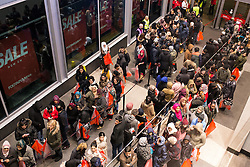 © Licensed to London News Pictures . 26/12/2014 .  Manchester , UK . Crowds of bargain hunters stream in to Manchester's Arndale Centre for a 6AM opening for the Next Boxing Day Sale . Photo credit : Joel Goodman/LNP