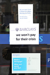 © Licensed to London News Pictures. 19/02/2011. UK Uncut Protest. Barclays Bank New Cross Road London London today (19/02/2011). Demonstrations against low levels of tax paid by Barclays bank. by Photo credit should read: Tony Nandi/London News Pictures