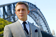 """British actor Daniel Craig poses in front of the Harbour Bridge in Sydney, Tuesday, Dec. 5, 2006. Craig, star of the new James Bond movie """"Casino Royale"""", is in Sydney to promote the film. (AP Photo/Paul Miller)"""