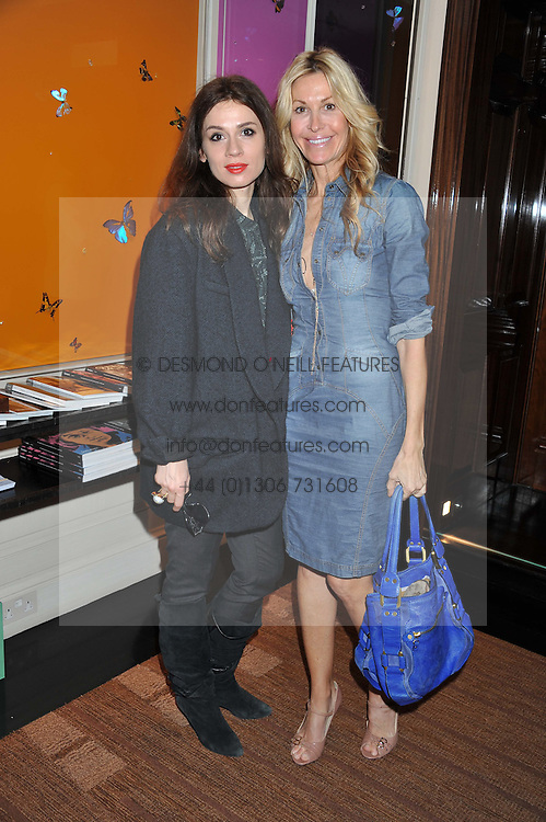 Left to right, LARA BOHINC and MELISSA ODABASH at a lunch to announce the partnership between Creme de la Mer and BLUE Marine Foundation held at Sotheby's 34-35 New Bond Street, London on 18th May 2012.