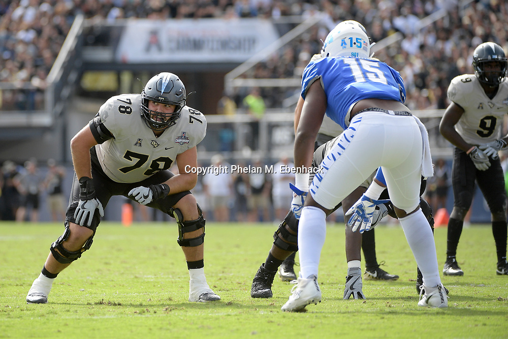 Central Florida offensive lineman Wyatt Miller (78) sets up to block against Memphis defensive lineman Christian Johnson (15) during the first half of the American Athletic Conference championship NCAA college football game Saturday, Dec. 2, 2017, in Orlando, Fla. (Photo by Phelan M. Ebenhack)