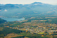 An aerial perspective of the town of Cumberland and proximity to Comox Lake give clear evidence to the amount of forest and recreational opportunities that exist around the township.  Comox Valley, Vancouver Island, British Columbia, Canada.
