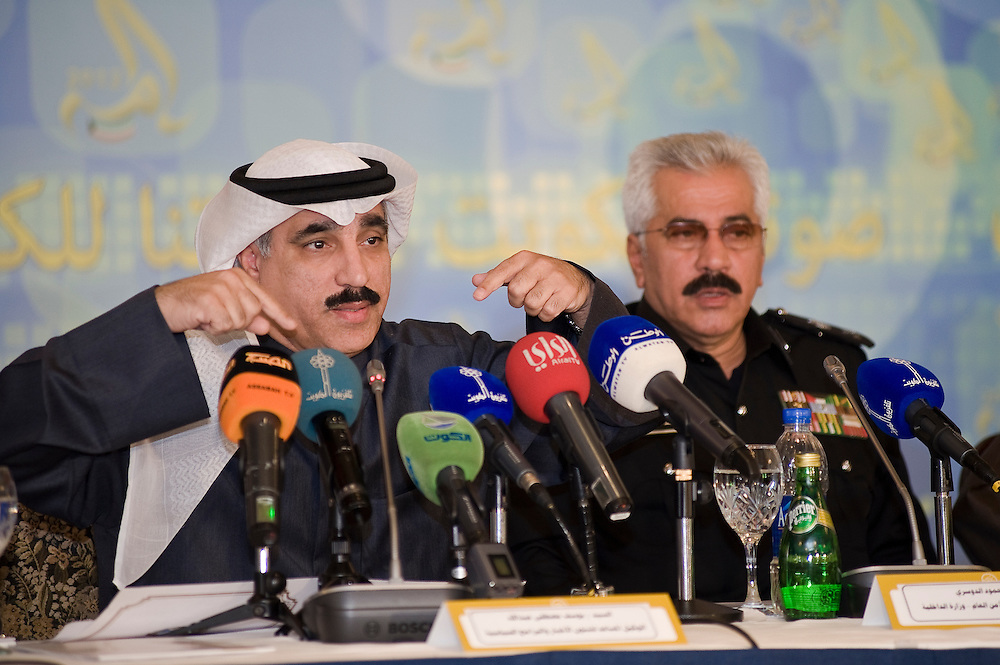 Yousef Mustafa Abdullah, an assistant undersecretary at the Kuwaiti Ministry of Information (L), gestures during a news conference in Kuwait City Feb 1 about preparations for the Feb. 2 parliamentary elections.