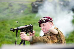 Re-enactors portraing British Paras of the 6th airborne division take part in a Battle reenactment on Day two at the Showground Pickering<br />
