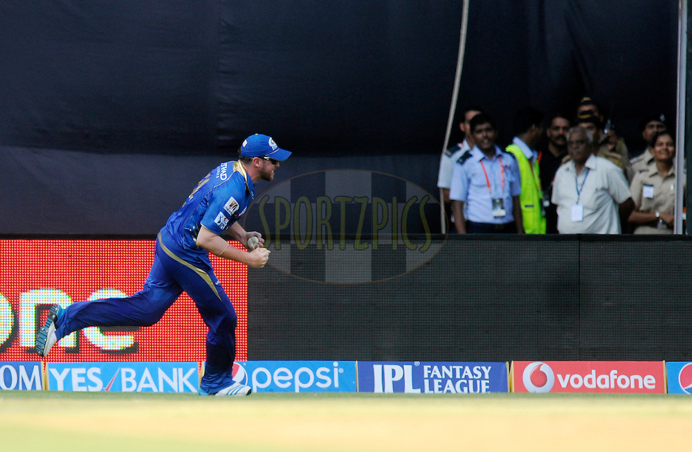 Ben Dunk of the Mumbai Indians celebrates after completing a catch to get the wicket of Glenn Maxwell of the Kings X1 Punjab during match 22 of the Pepsi Indian Premier League Season 2014 between the Mumbai Indians and the Kings XI Punjab held at the Wankhede Cricket Stadium, Mumbai, India on the 3rd May  2014<br /> <br /> Photo by Pal Pillai / IPL / SPORTZPICS<br /> <br /> <br /> <br /> Image use subject to terms and conditions which can be found here:  http://sportzpics.photoshelter.com/gallery/Pepsi-IPL-Image-terms-and-conditions/G00004VW1IVJ.gB0/C0000TScjhBM6ikg