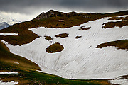 Patches of white snow is seen in the Gurnigel Pass in Switzerland. The glaciers in the Alps are melting fast due to the global warming, and many of them are projected to be gone by 2070. The white snow cover reflects the sunlight and the heat much better than the darker ice. The winter of 2017/2018 saw record amounts of snow in the alps, but record high temperatures in the summer melted most of it already in June.