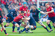 Connor Murray (#9) of Munster Rugby is tackled by Grant Gilchrist (#5) of Edinburgh Rugby during the Heineken Champions Cup quarter-final match between Edinburgh Rugby and Munster Rugby at BT Murrayfield Stadium, Edinburgh, Scotland on 30 March 2019.
