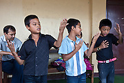 Young Nepalese children dance to music during a class at the Voice of Children rehabilitation center in Kathmandu,Kathmandu, Nepal. The not-for-profit organisation supports street children and those who are at risk of sexual abuse through educational and vocational training opportunities, health services and psychosocial counseling.