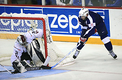 Tomaz Razingar of Slovenia vs Goalkeeper Edgars Masalskis at ice-hockey match Slovenia vs Latvia at Preliminary Round (group B) of IIHF WC 2008 in Halifax, on May 06, 2008 in Metro Center, Halifax, Nova Scotia, Canada. Latvia won 3:0. (Photo by Vid Ponikvar / Sportal Images)Slovenia played in old replika jerseys from the year 1966, when Yugoslavia hosted the World Championship in Ljubljana.