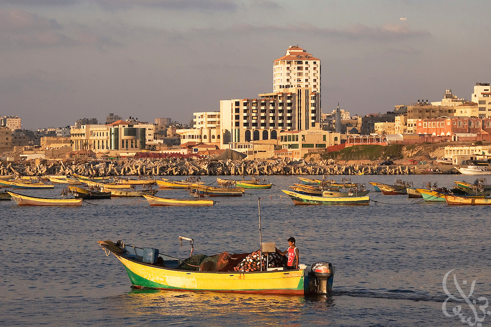 The Palestinian fishing fleet in Gaza harbor remains in port during the normally busy evening hours August 05, 2007 in Gaza. Under the Palestinian Authority, fishermen were able to get permission from the Israeli Navy, which maintains a blockade just off the coast of Gaza, to fish several miles from shore. Since the takeover of Gaza by Hamas in June, fisherman have had a much tougher time getting the permission, and have been fishing close to shore or not leaving port at all, creating a further economic crisis in the strip. .