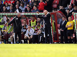 Swindon Town Manger, Kevin MacDonald complains to the 4th official but Brentford Manger, Uwe Rosler  claims a dive - Photo mandatory by-line: Joe Meredith/JMP - Tel: Mobile: 07966 386802 04/05/2013 - SPORT - FOOTBALL - County Ground - Swindon - Swindon Town v Brentford - Npower League one Play Off